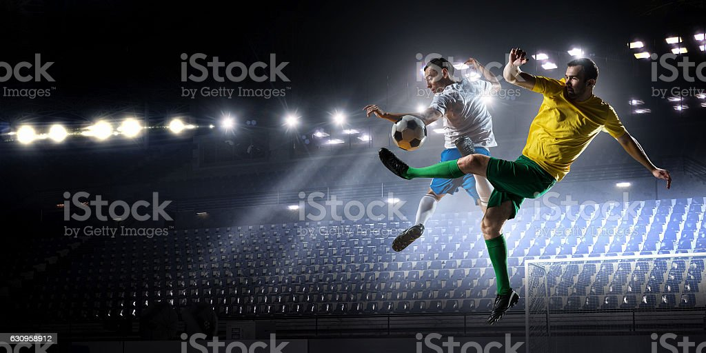 Soccer palyers fighting for ball . Mixed media stock photo