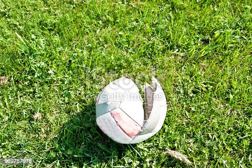 637297180 istock photo Soccer Pitch - Burst (Damaged) Soccer Ball 969757978