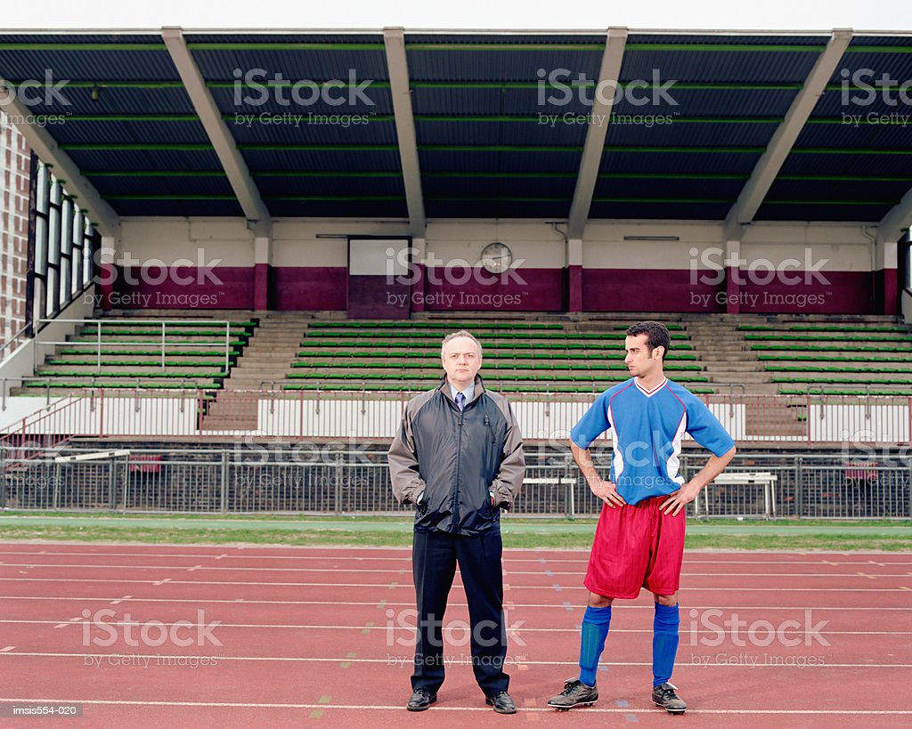 Soccer player and coach royalty-free stock photo