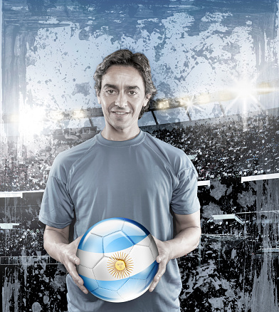istock Soccer player Argentina holding ball with argentinian flag 928395106