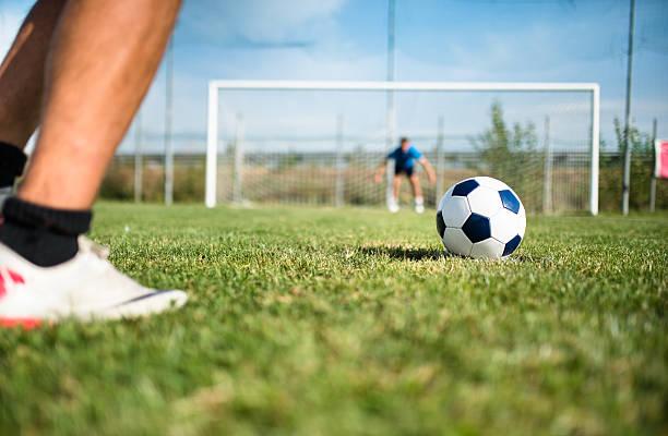 soccer player at the penalty - soccer goal stockfoto's en -beelden