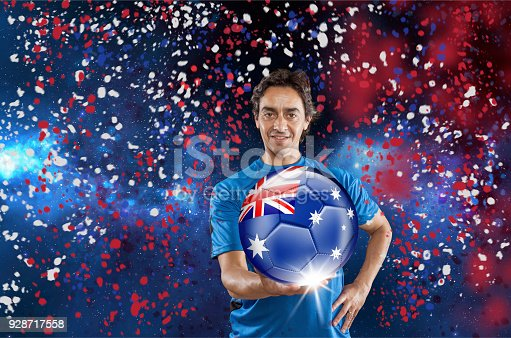 istock Soccer player Australia holding ball with australian flag under confetti 928717558