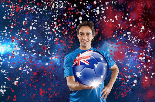 istock Soccer player Australia holding ball with australian flag under confetti 928717558