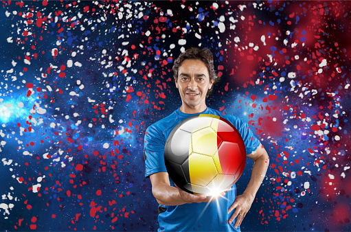 istock Soccer player Belgium holding ball with belgian flag under confetti 928722142