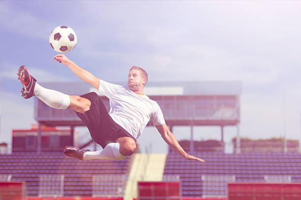 soccer player bicycle kick, modern stock photo