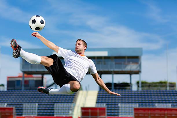 soccer player bicycle kick stock photo