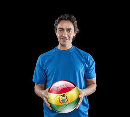 istock Soccer player Bolivia holding ball with bolivian flag 928725386