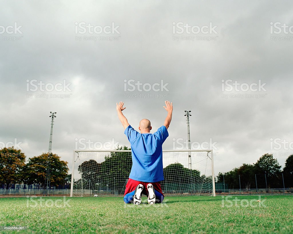 Soccer player celebrating royalty-free stock photo