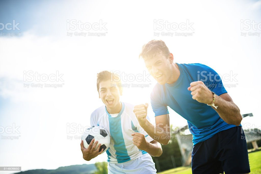 soccer player cheering after the winning stock photo