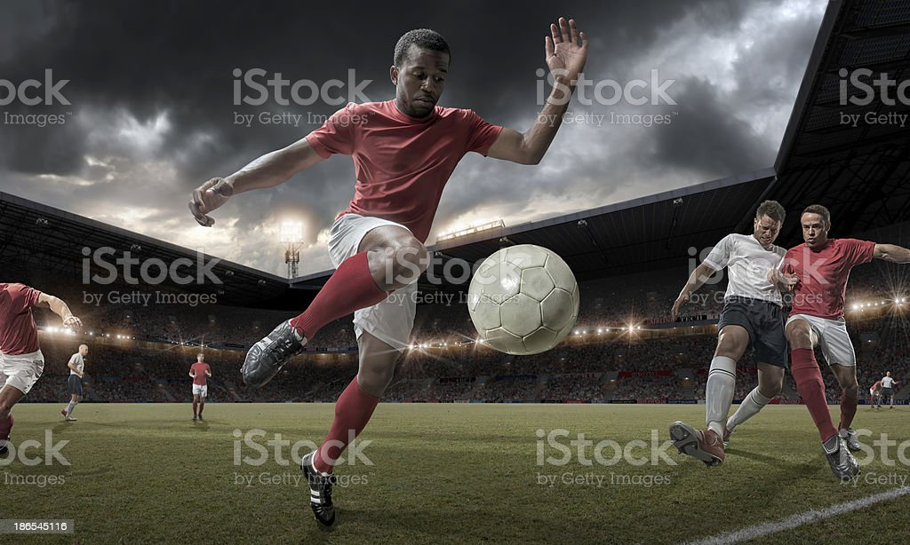 Soccer Player Controlling Ball in Mid Match Action stock photo