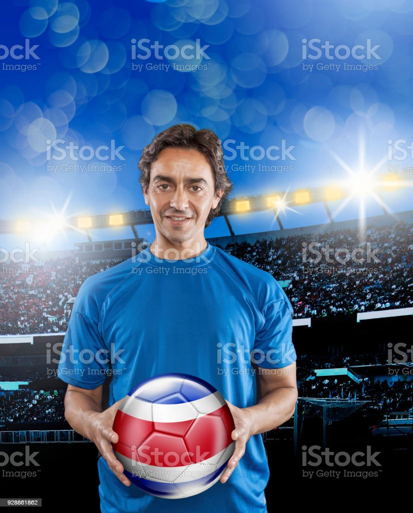 Soccer player Costa Rica holding ball with national flag in stadium stock photo