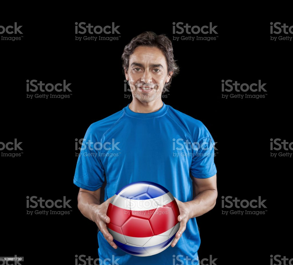 Soccer player Costa Rica holding ball with national flag isolated on black stock photo