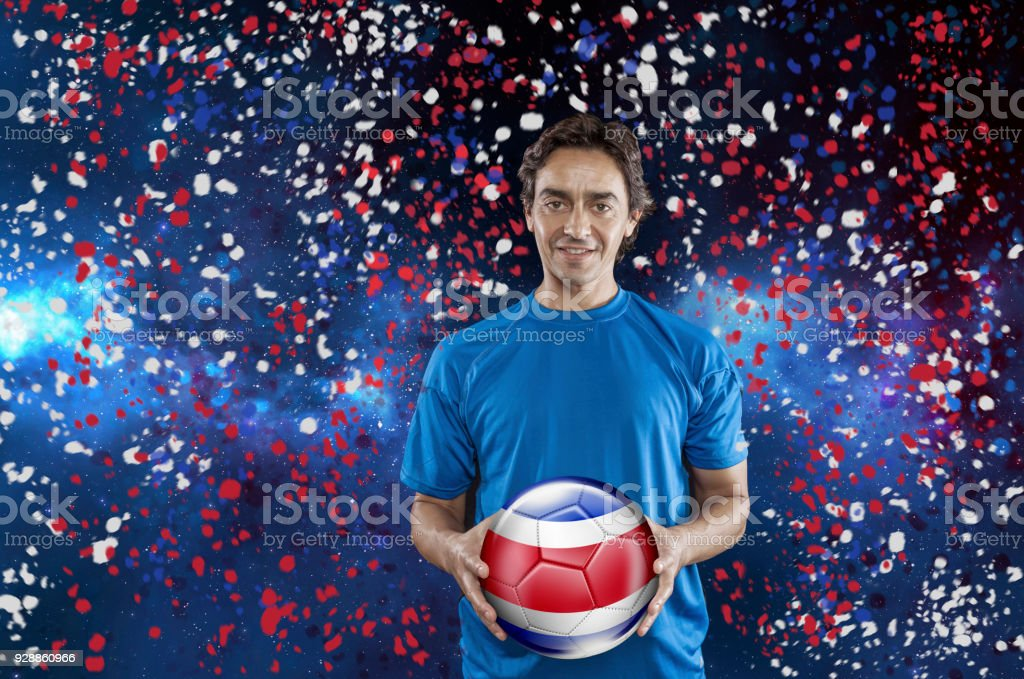 Soccer player Costa Rica holding ball with national flag under confetti stock photo