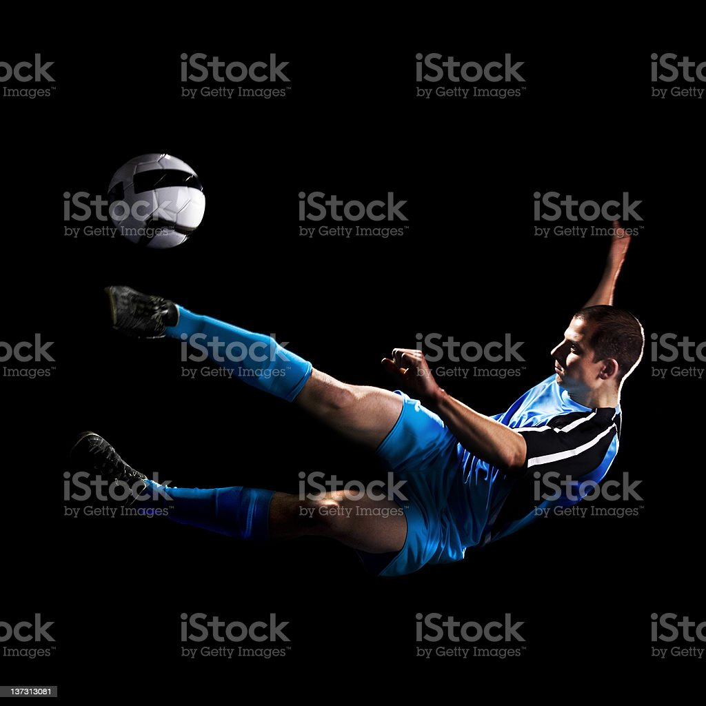 Soccer Player Doing Air kick stock photo