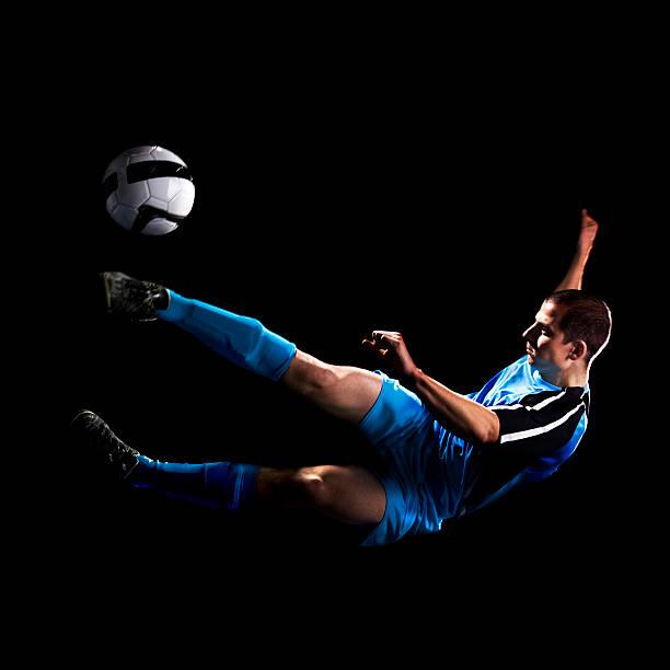 Soccer Player Doing Air kick stock photo