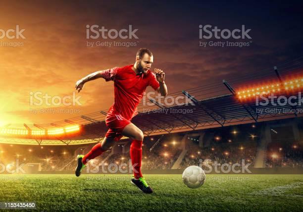 Soccer player dribbles a ball picture id1153435450?b=1&k=6&m=1153435450&s=612x612&h=bjjbninsathu08v4i4awdaui2nogxndq01 bifvnw1e=