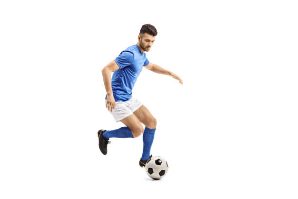 soccer player dribbling - soccer player stock photos and pictures
