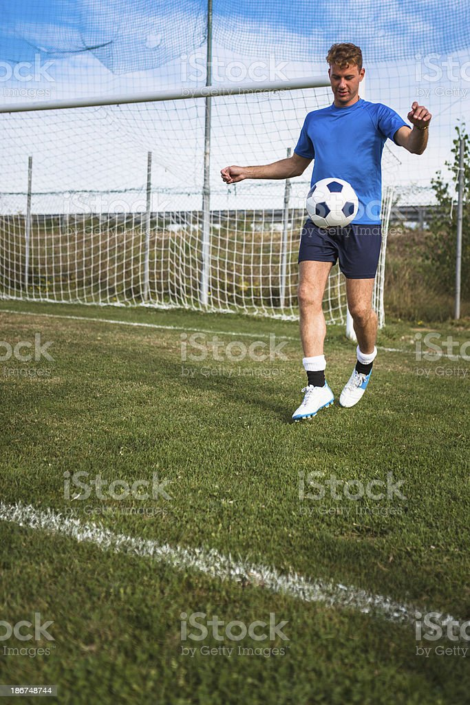 Soccer player enjoying with the ball royalty-free stock photo