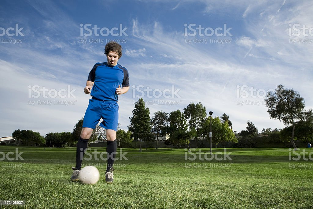 Soccer Player exercising with ball royalty-free stock photo