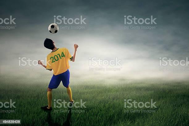 Soccer player heading ball picture id494839409?b=1&k=6&m=494839409&s=612x612&h=fr6s4hwh g86mzi227tdo3 rqjzxel7l5pzns0jlrba=