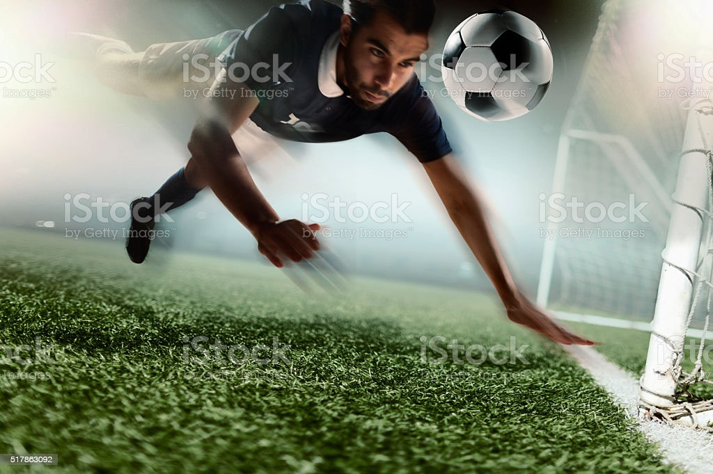 Soccer player heading soccer ball stock photo