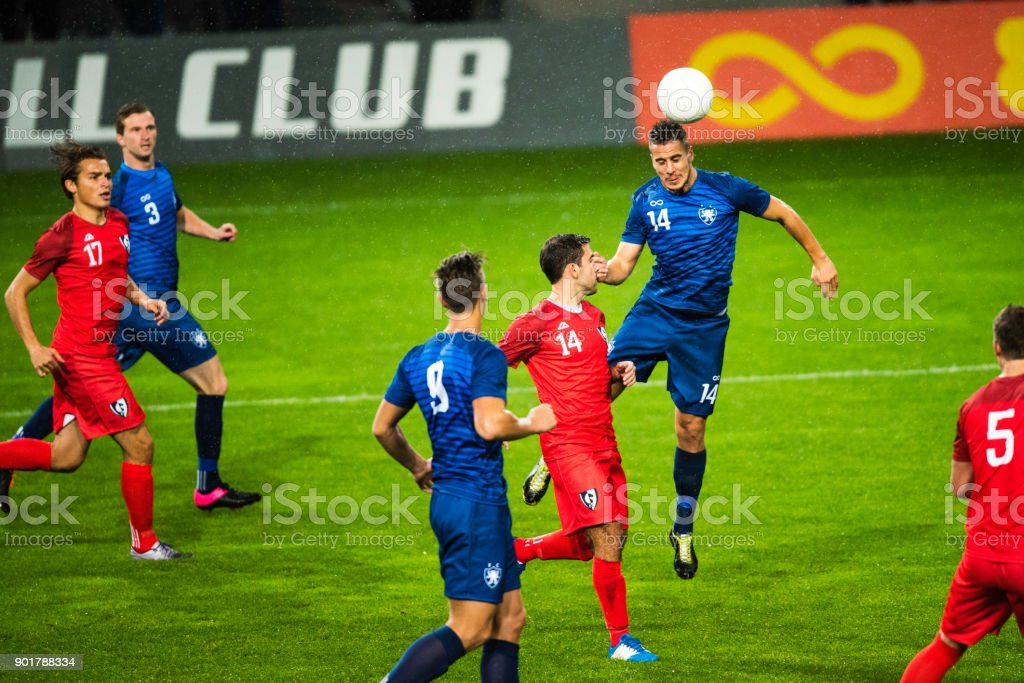 Soccer player heading the ball stock photo