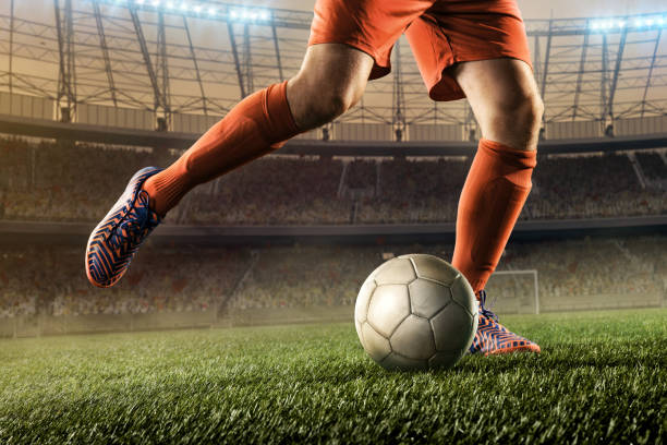 soccer player hits a ball stock photo