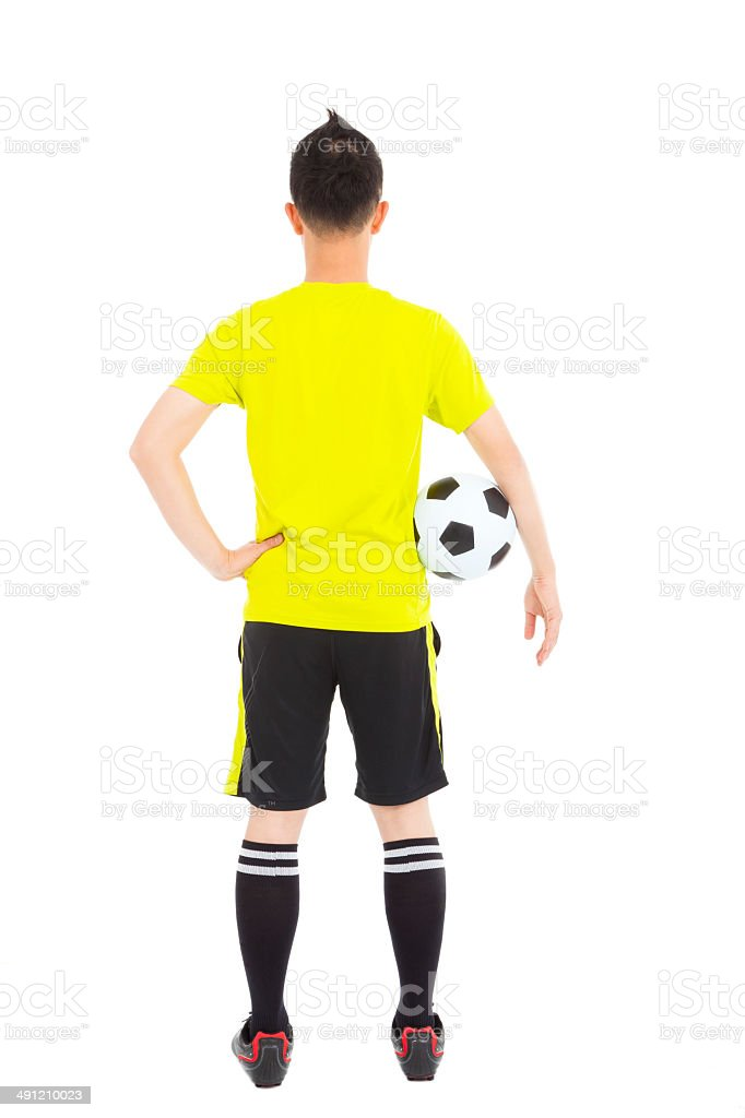 soccer player holding a soccer next to  waist stock photo