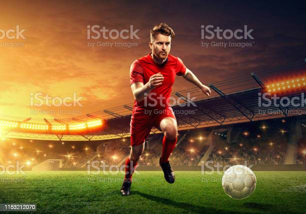 Soccer player in action on professional soccer stadium picture id1153212070?b=1&k=6&m=1153212070&s=612x612&h=sgei4o2ljlvim8jk2lh1zbnfjgnb6eiicvvqyd g9hm=