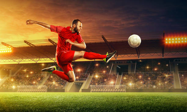 soccer player in action on professional soccer stadium. - soccer league stock pictures, royalty-free photos & images