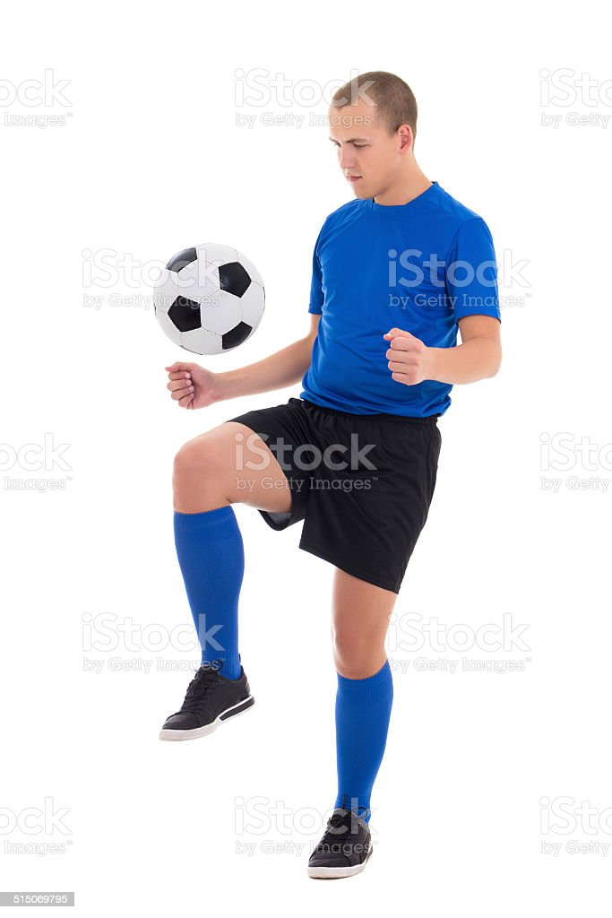 soccer player in blue uniform playing with ball isolated stock photo