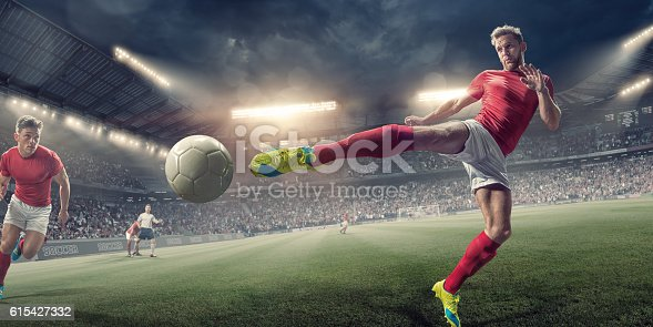 istock Soccer Player in Mid Air Volley Action During Football Match 615427332
