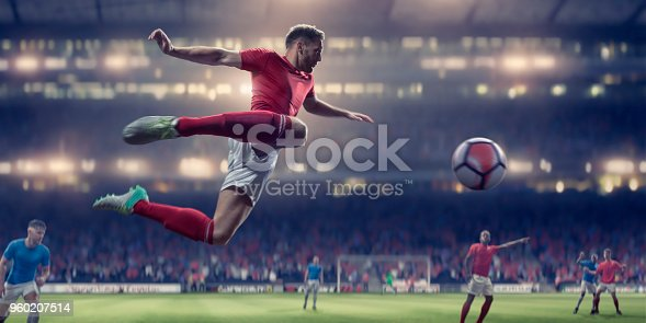 istock Soccer Player In Mid Air Volley Ball During Football Match 960207514