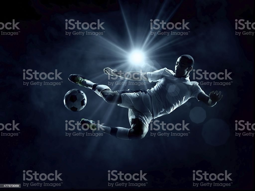 Soccer Player in mid-air stock photo