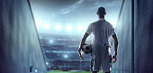 istock Soccer player in players zone of a stadium 471298860