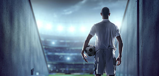 Soccer player in players zone of a stadium stock photo