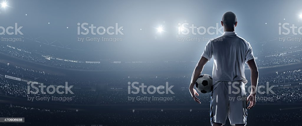 Soccer player in stadium stock photo