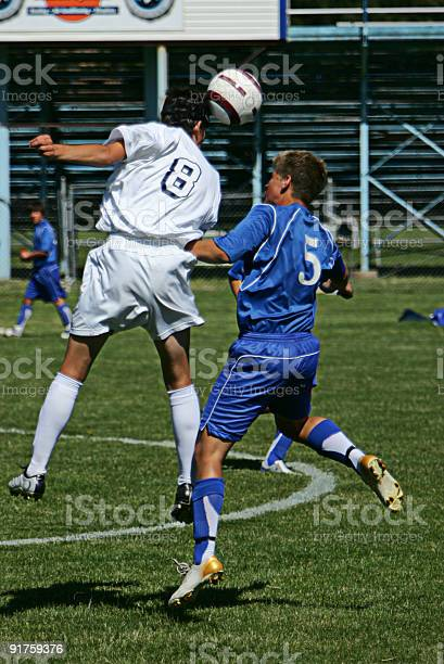 Soccer player in white heads ball over opponent in midair picture id91759376?b=1&k=6&m=91759376&s=612x612&h=prfdgjoa86qxxnn9pwlps1kbplyd zkxfk1ckwxhh44=