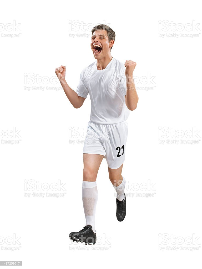 Soccer player is happy after scoring a goal royalty-free stock photo