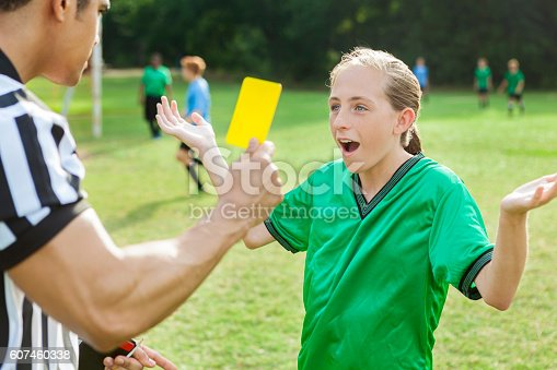 istock Soccer player is upset over referee's penalty call 607460338