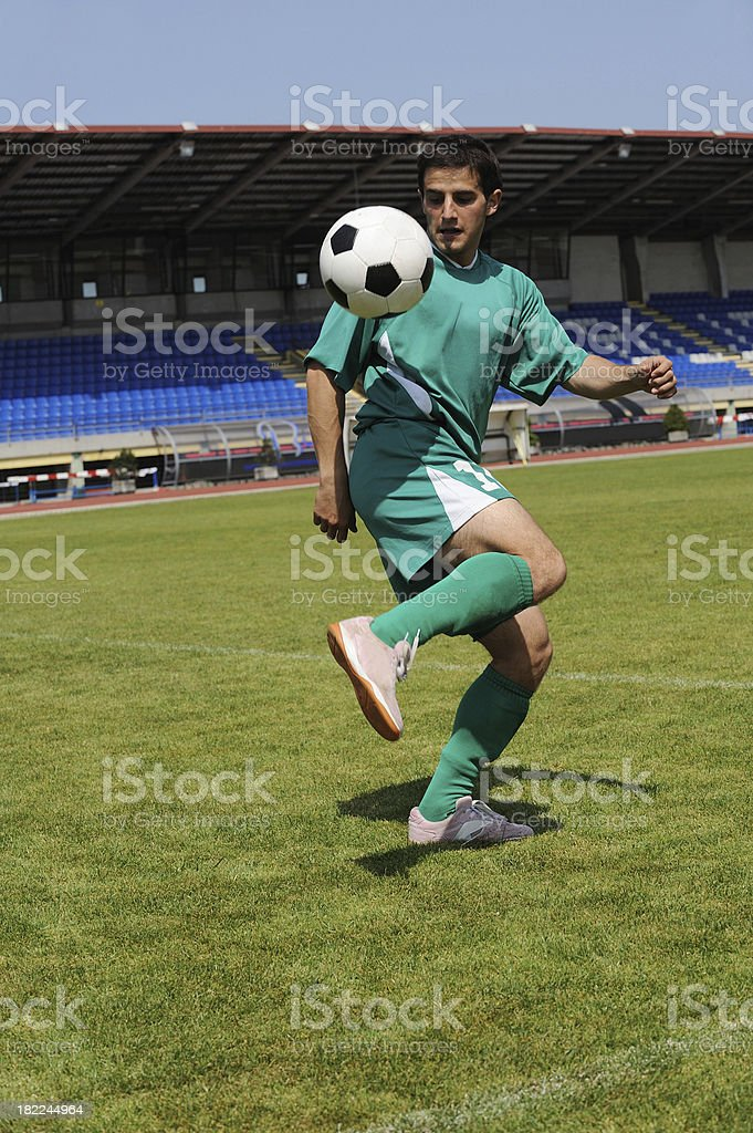 Soccer player juggling royalty-free stock photo