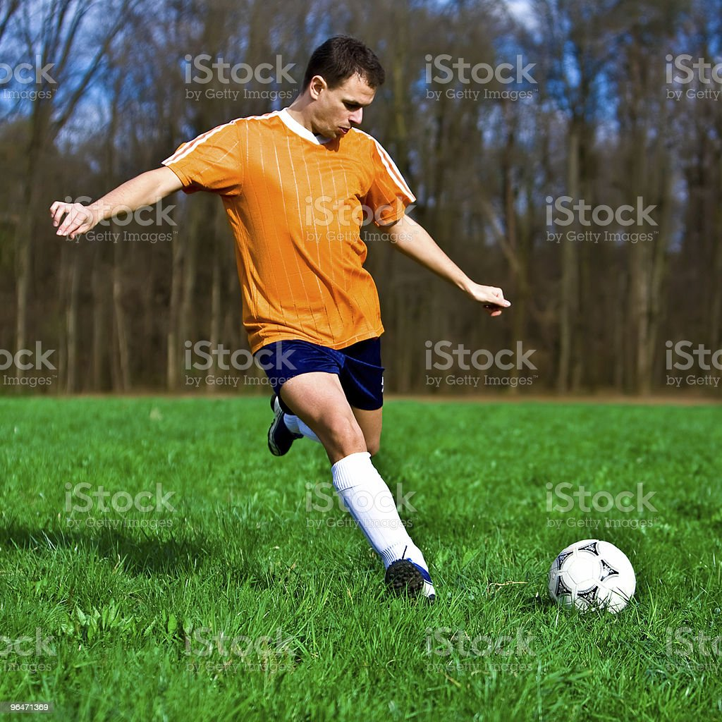 Soccer player kicking 2 royalty-free stock photo