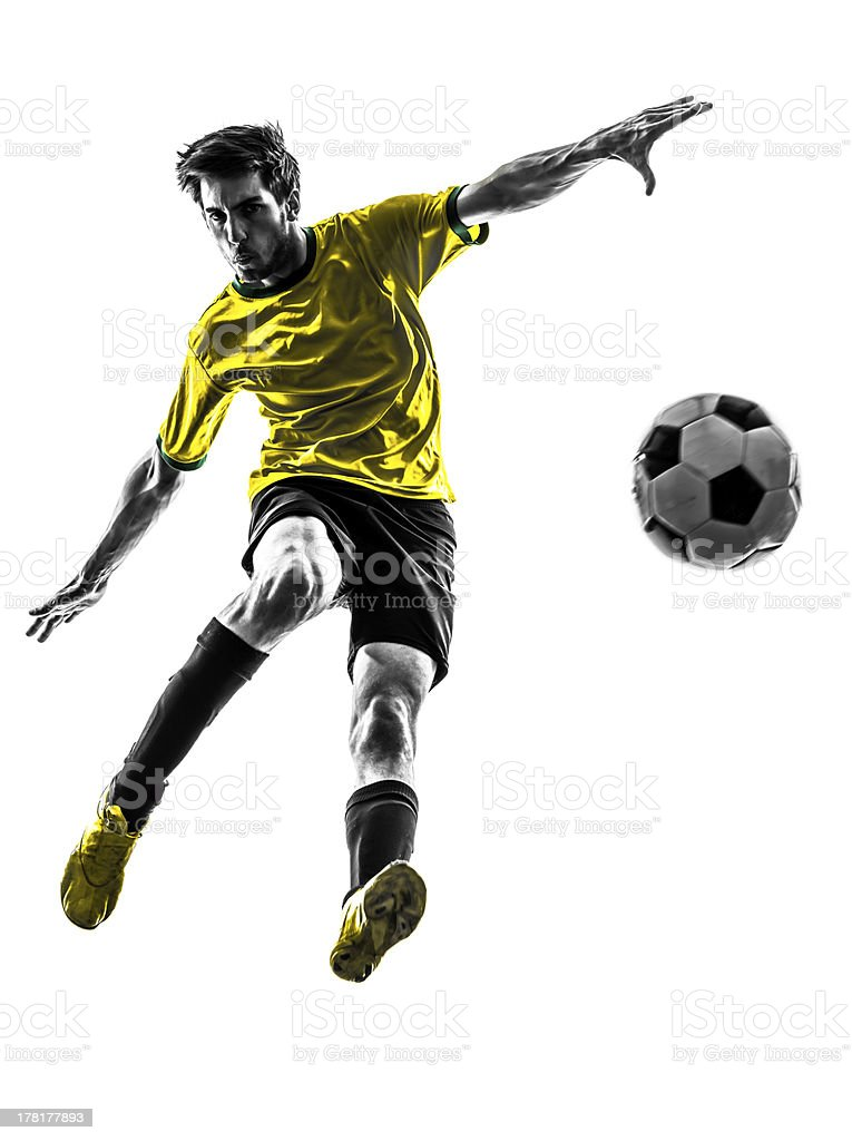 b4b0021a4 Soccer player kicking ball on white background royalty-free stock photo