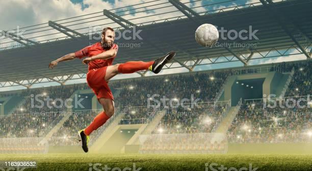 Soccer player kicking ball soccer stadium picture id1163936532?b=1&k=6&m=1163936532&s=612x612&h=khuepb8je4lzirrrg1c1mdrweba6m9jjmtnmrd9pnou=