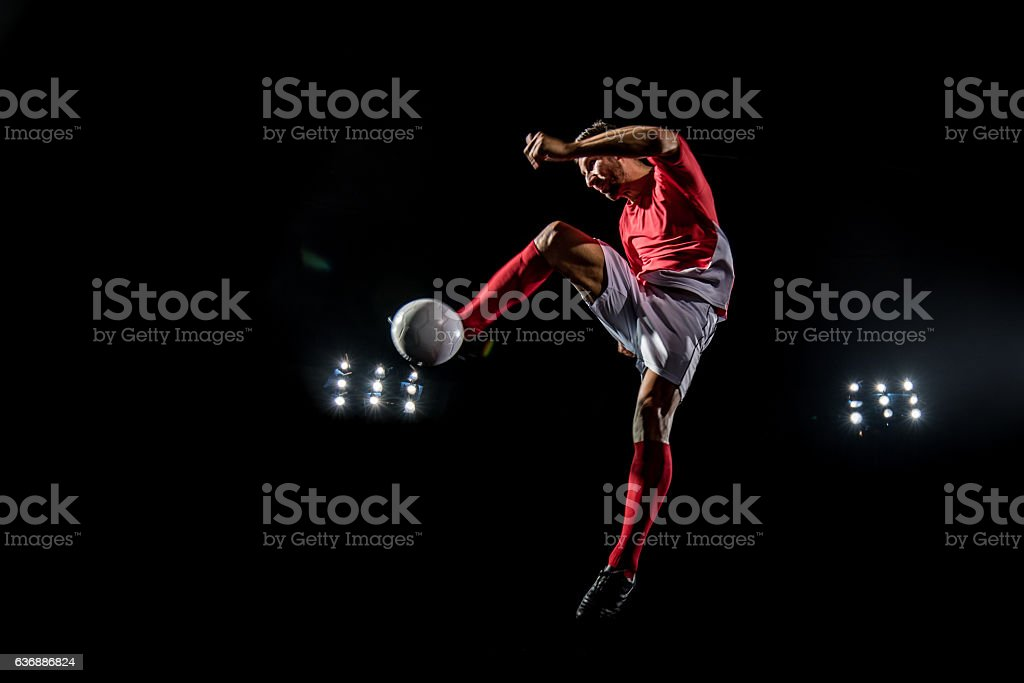 Soccer player kicking stock photo