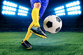 istock Soccer player kicking the ball 498848275
