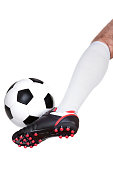istock Soccer player kicking the ball 519520552