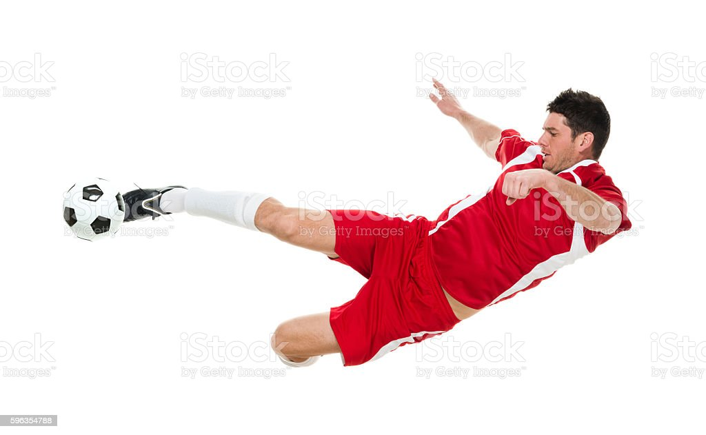 Soccer player kicking the ball royalty-free stock photo