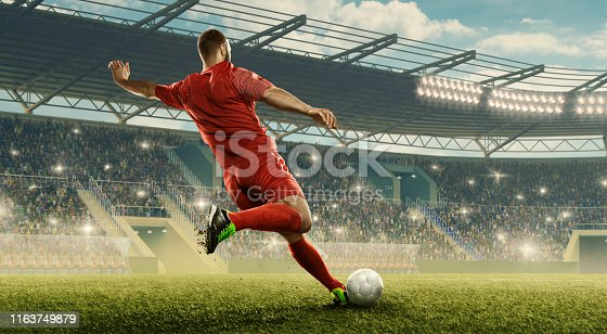 Professional soccer player with a ball in action. Soccer stadium with tribunes and fans cheering. Sports event