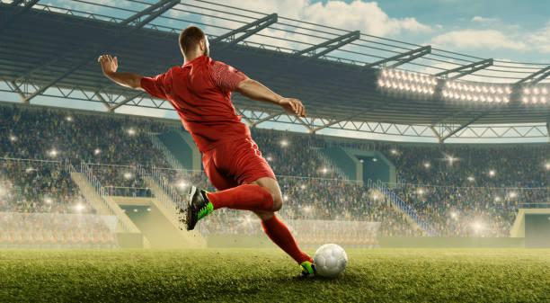 le joueur de football frappe une bille - football photos et images de collection